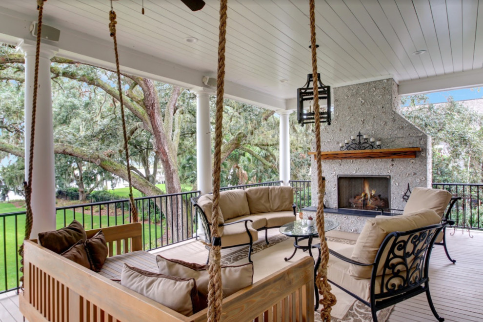 Inspiration for a mid-sized transitional backyard deck remodel in Atlanta with a fire pit and a roof extension