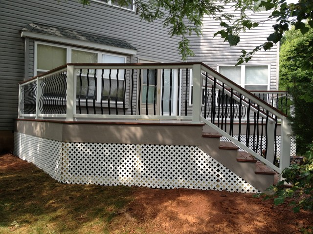 Vinyl deck with custom railing rustic deck other for Rustic porches and decks
