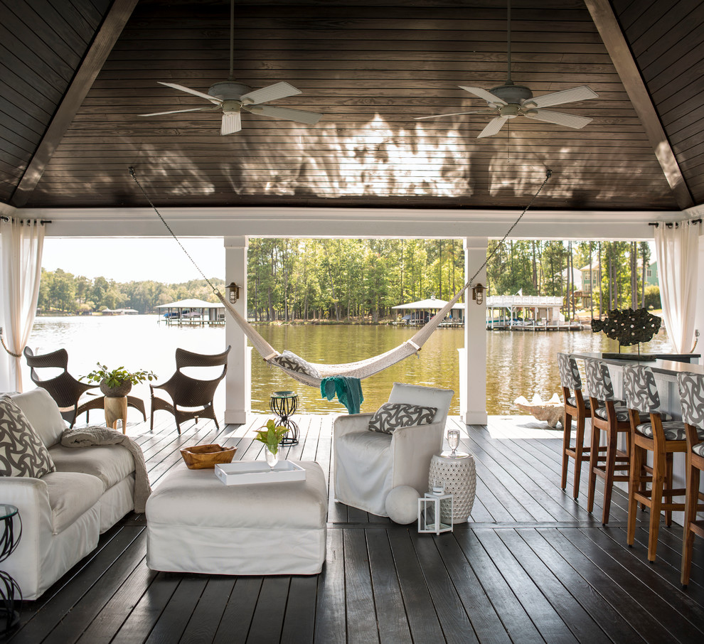Outdoor kitchen deck - large coastal backyard outdoor kitchen deck idea in Raleigh with a roof extension