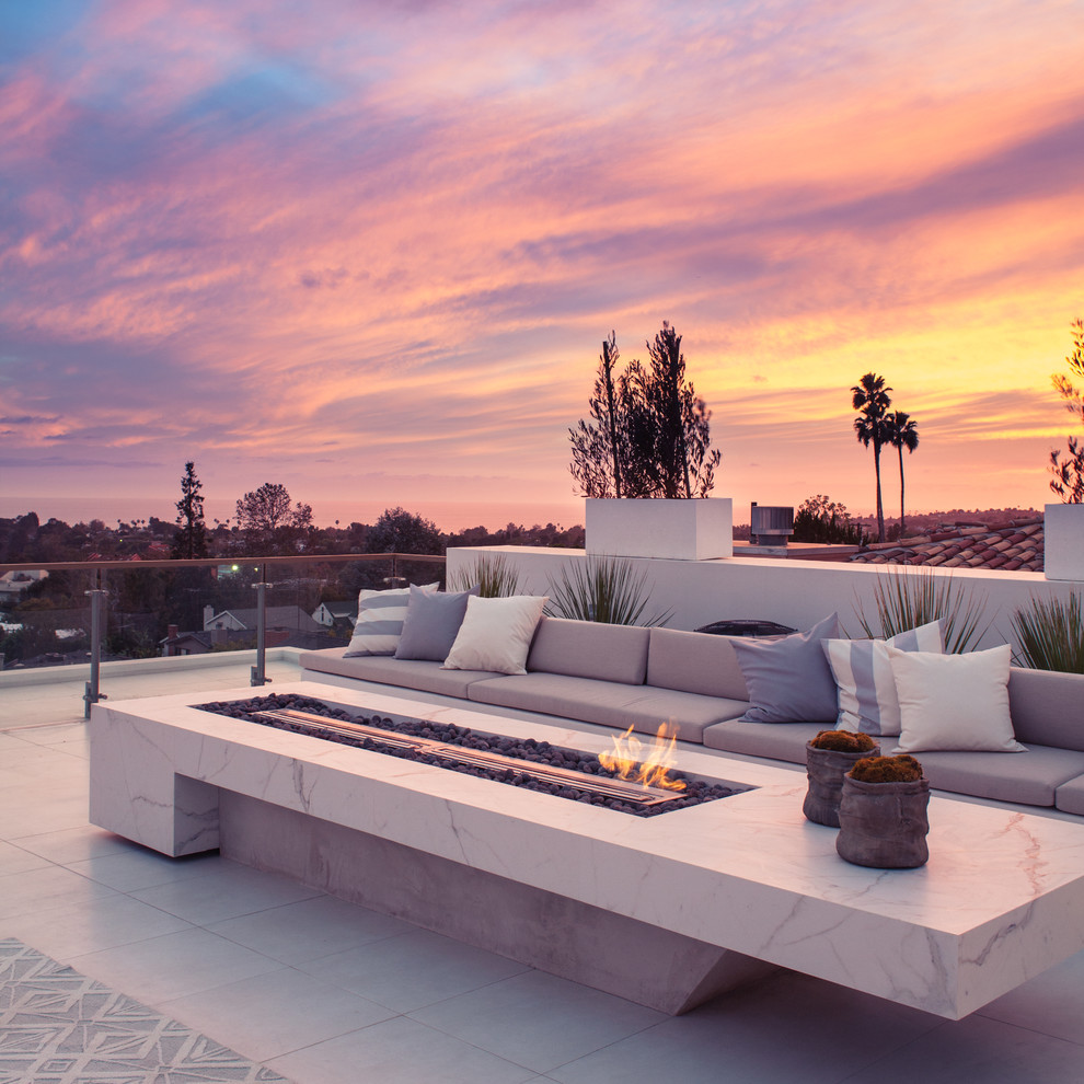Inspiration for a huge contemporary rooftop deck remodel in Los Angeles with a fire pit and no cover