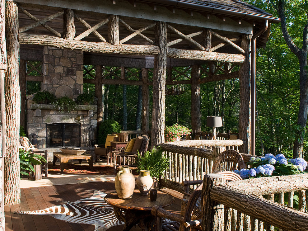 Deck - large rustic backyard deck idea in Atlanta with a fire pit and a roof extension