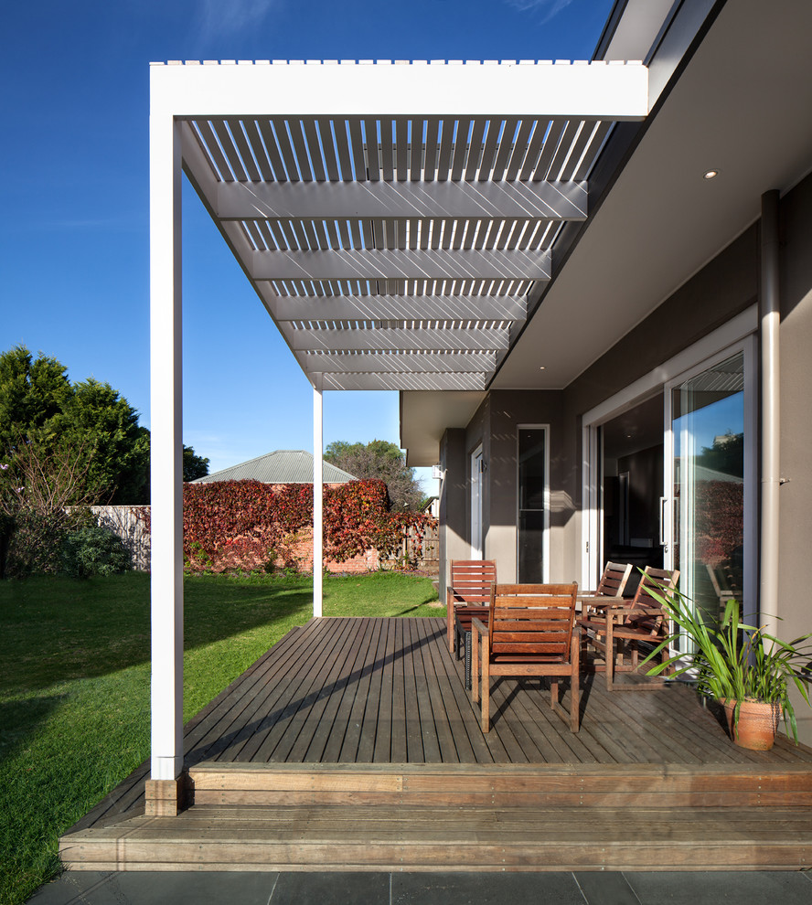 Mid-sized contemporary backyard deck in Melbourne with a pergola.