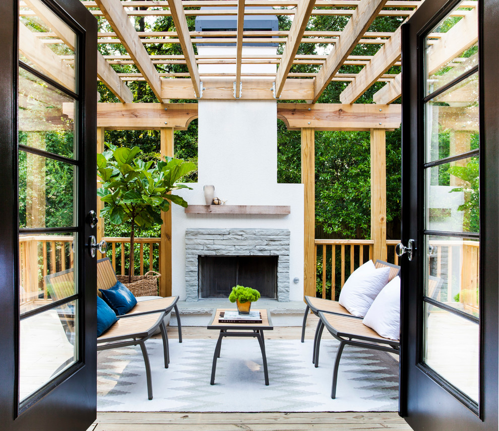 Mid-sized transitional backyard deck photo in Atlanta with a fire pit and a pergola