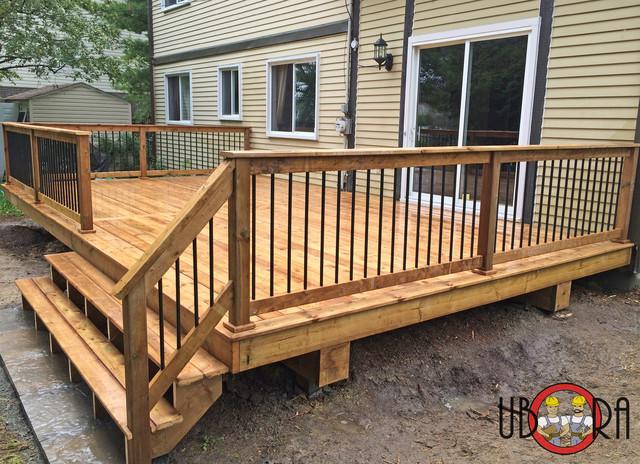 Wood Deck With Black Metal Spindle Railings Terrace