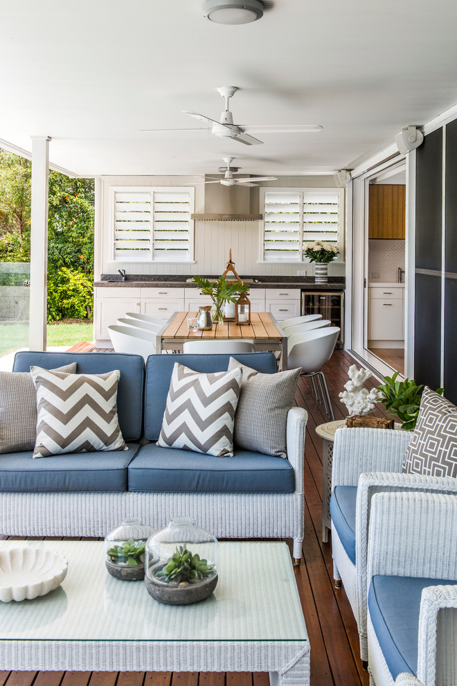 Inspiration for a timeless backyard outdoor kitchen deck remodel in Brisbane with a roof extension