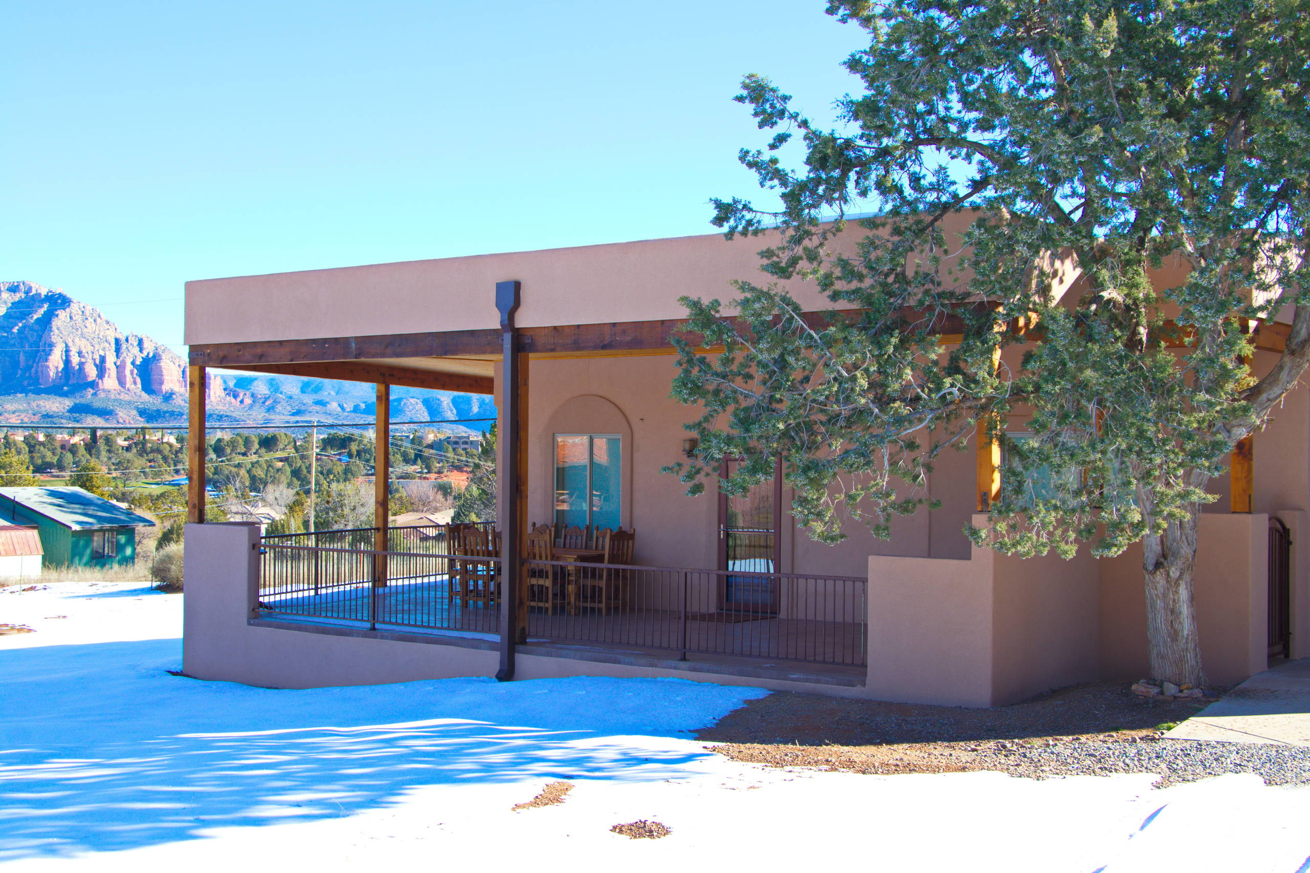 Wrap-around patio with roof deck