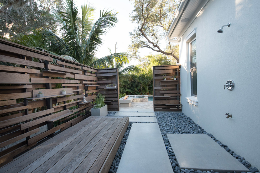 Outdoor shower deck - contemporary side yard outdoor shower deck idea in Tampa with no cover