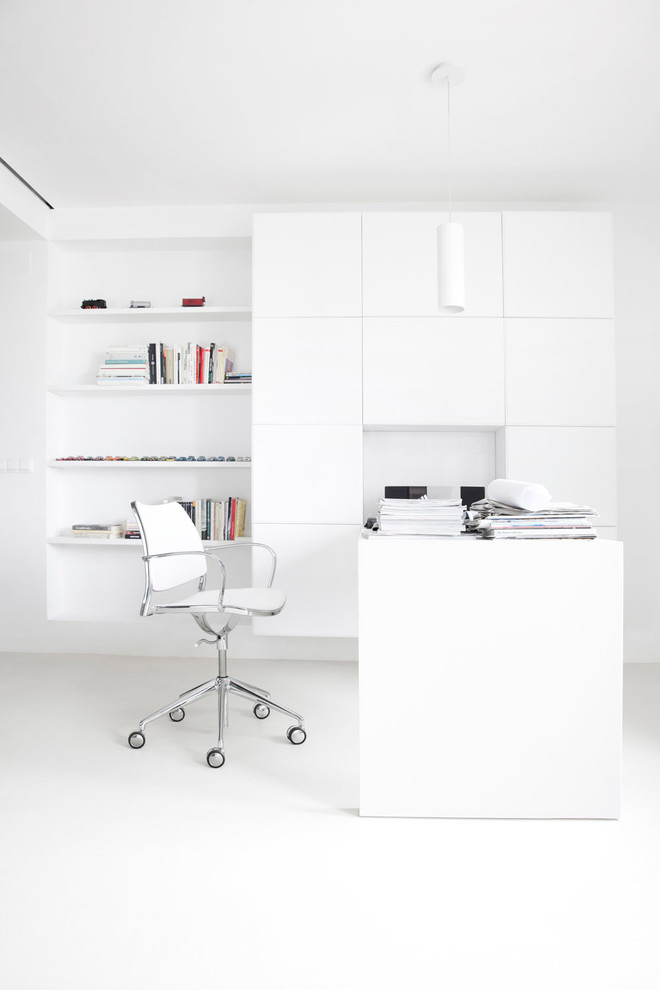 Mid-sized trendy freestanding desk study room photo in Other with white walls and no fireplace