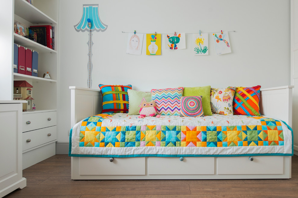Small trendy girl kids' room photo in Moscow with white walls