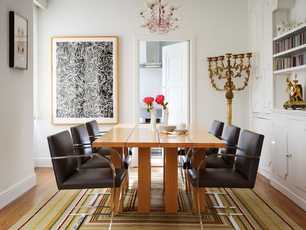Minimalist medium tone wood floor enclosed dining room photo in San Francisco with white walls