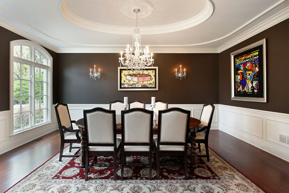 Inspiration for a large timeless dark wood floor and brown floor enclosed dining room remodel in Chicago with black walls and no fireplace
