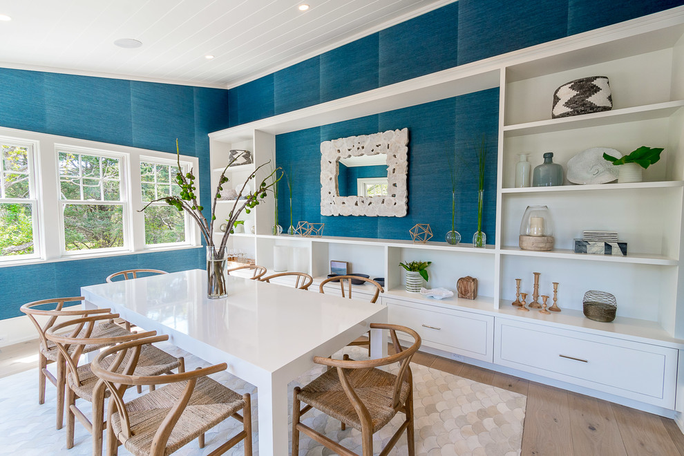 Inspiration for a beach style light wood floor and beige floor enclosed dining room remodel in Boston with blue walls