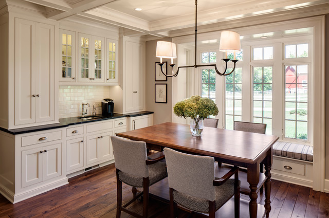 Country Dark Wood Floor Dining Room Photo In Milwaukee With White Walls
