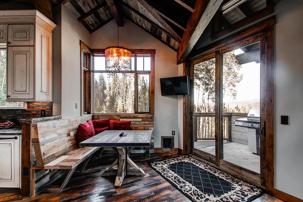 Kitchen/dining room combo - rustic dark wood floor kitchen/dining room combo idea in Denver with gray walls