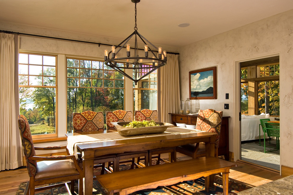 Example of a mountain style medium tone wood floor dining room design in New York with beige walls