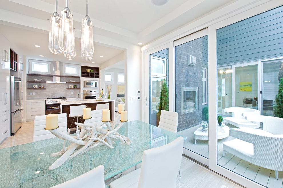 Inspiration for a modern kitchen/dining room combo remodel in Calgary with white walls