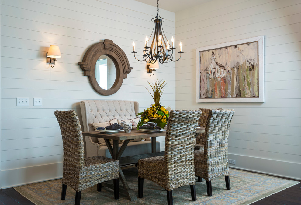 Elegant dark wood floor dining room photo in Other with white walls