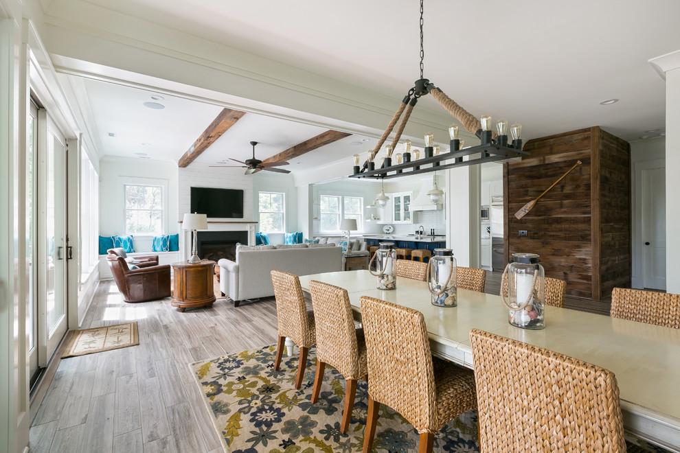 Great room - coastal medium tone wood floor great room idea in Charleston with white walls