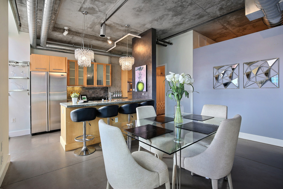 Urban concrete floor kitchen/dining room combo photo in Denver with no fireplace and purple walls