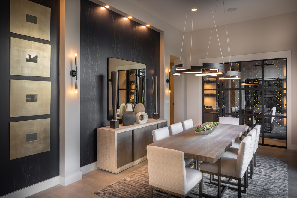 Inspiration for a large contemporary porcelain tile and beige floor dining room remodel in Austin with beige walls and no fireplace