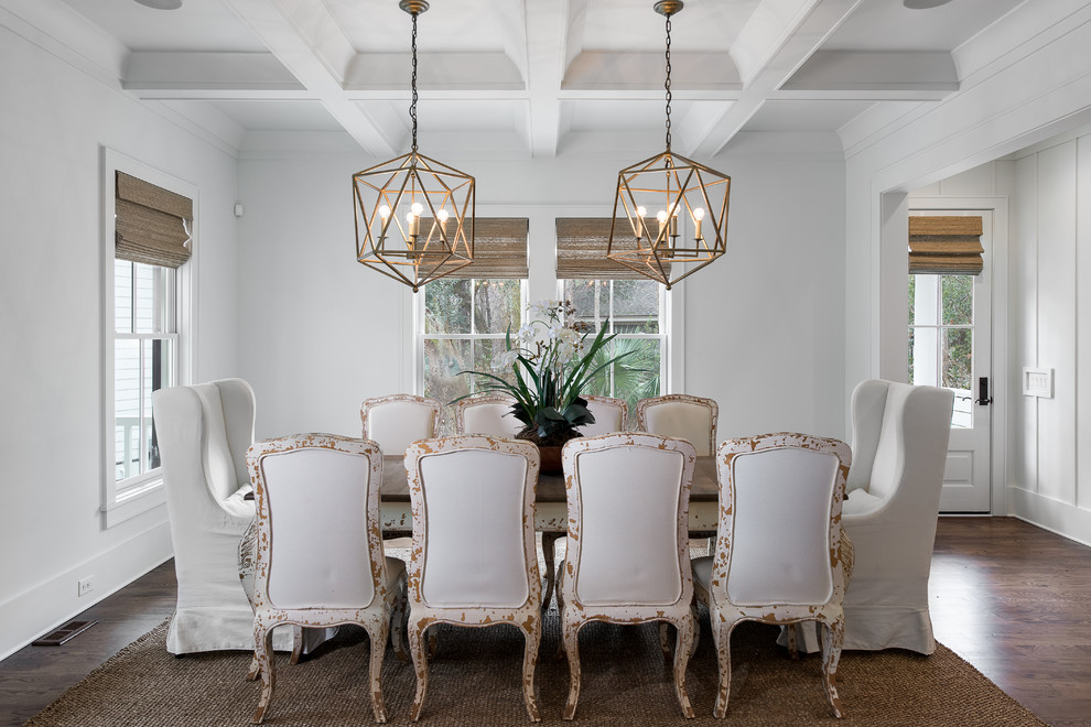 Example of a beach style dark wood floor dining room design in Charleston with white walls