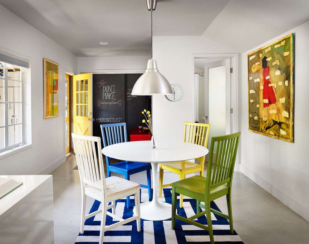 Inspiration for a contemporary concrete floor and gray floor dining room remodel in Austin