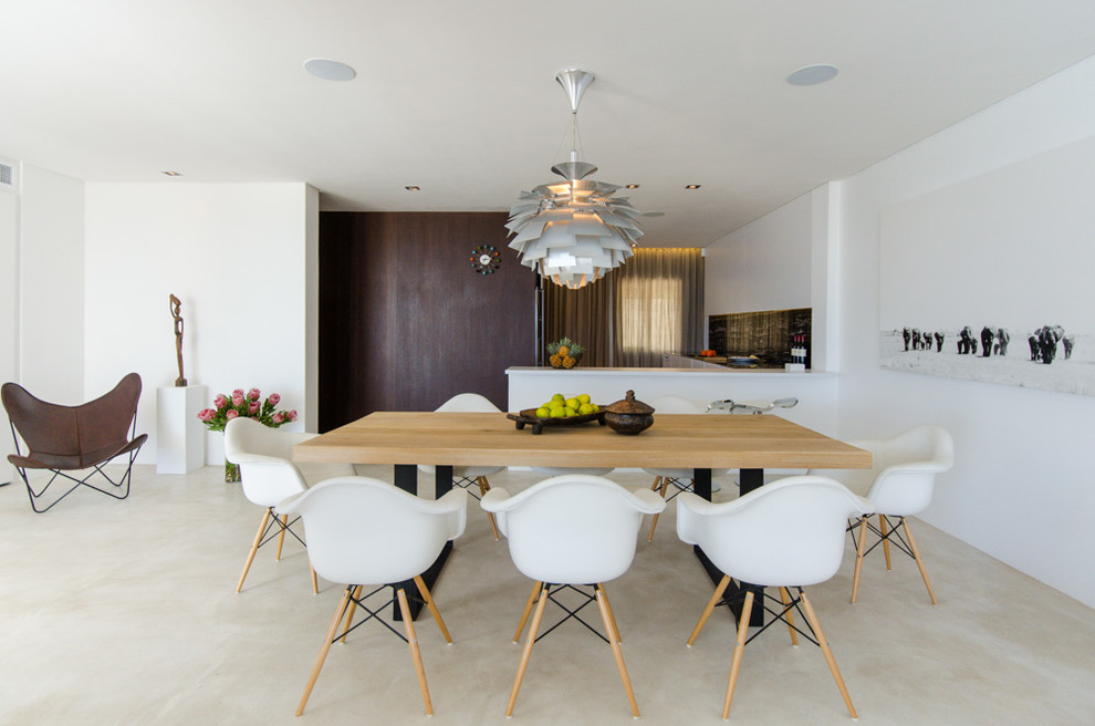 Example of a minimalist concrete floor dining room design in Other