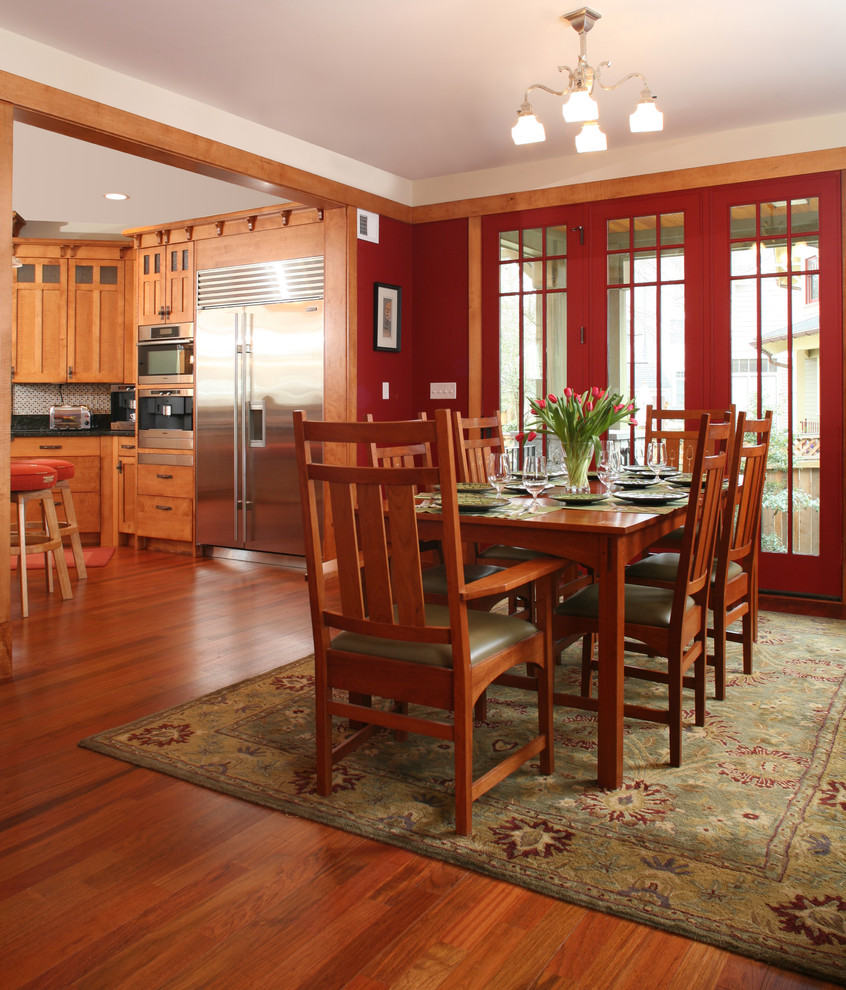 Inspiration for a craftsman dark wood floor kitchen/dining room combo remodel in Seattle with red walls