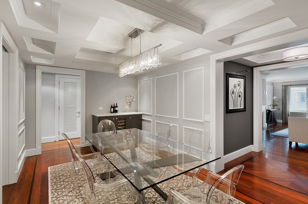 Enclosed dining room - mid-sized transitional dark wood floor enclosed dining room idea in New York with gray walls and no fireplace