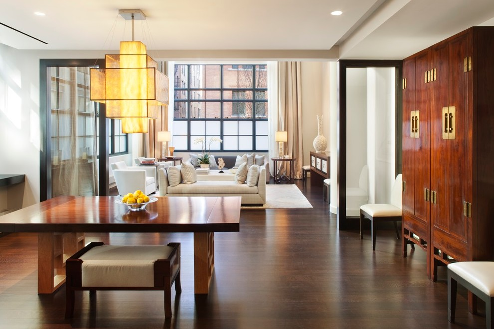 Inspiration for a zen dark wood floor dining room remodel in New York with white walls