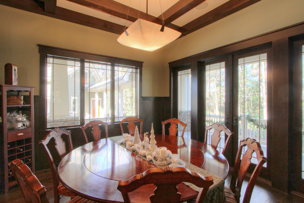 Example of an arts and crafts dark wood floor dining room design in Atlanta