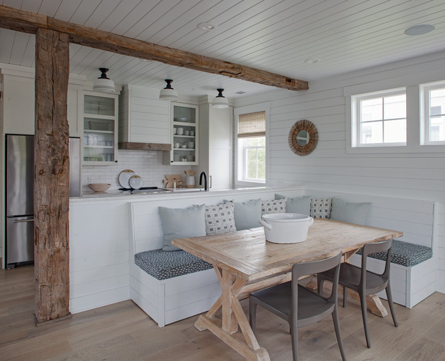 Example of a mid-sized coastal light wood floor and brown floor kitchen/dining room combo design with white walls and no fireplace
