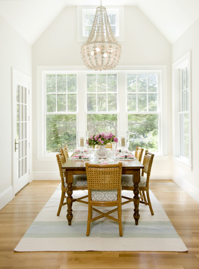 Mid-sized elegant medium tone wood floor great room photo in Boston with beige walls and no fireplace