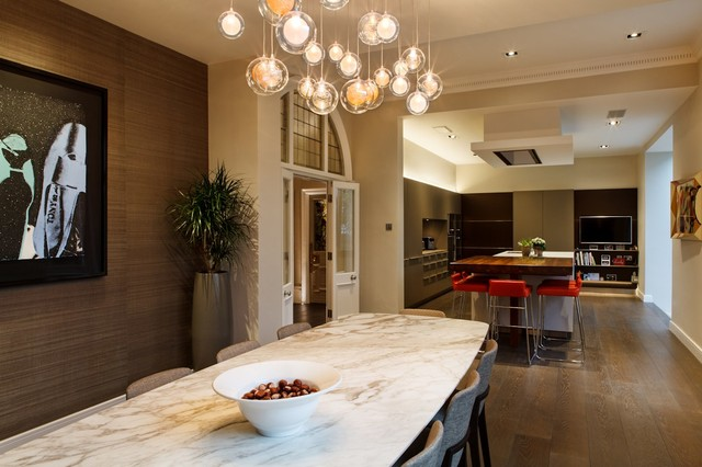 A Custom Chandelier In The Dining Area Contemporary
