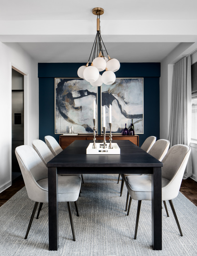Example of a small trendy dark wood floor enclosed dining room design in New York with blue walls and no fireplace