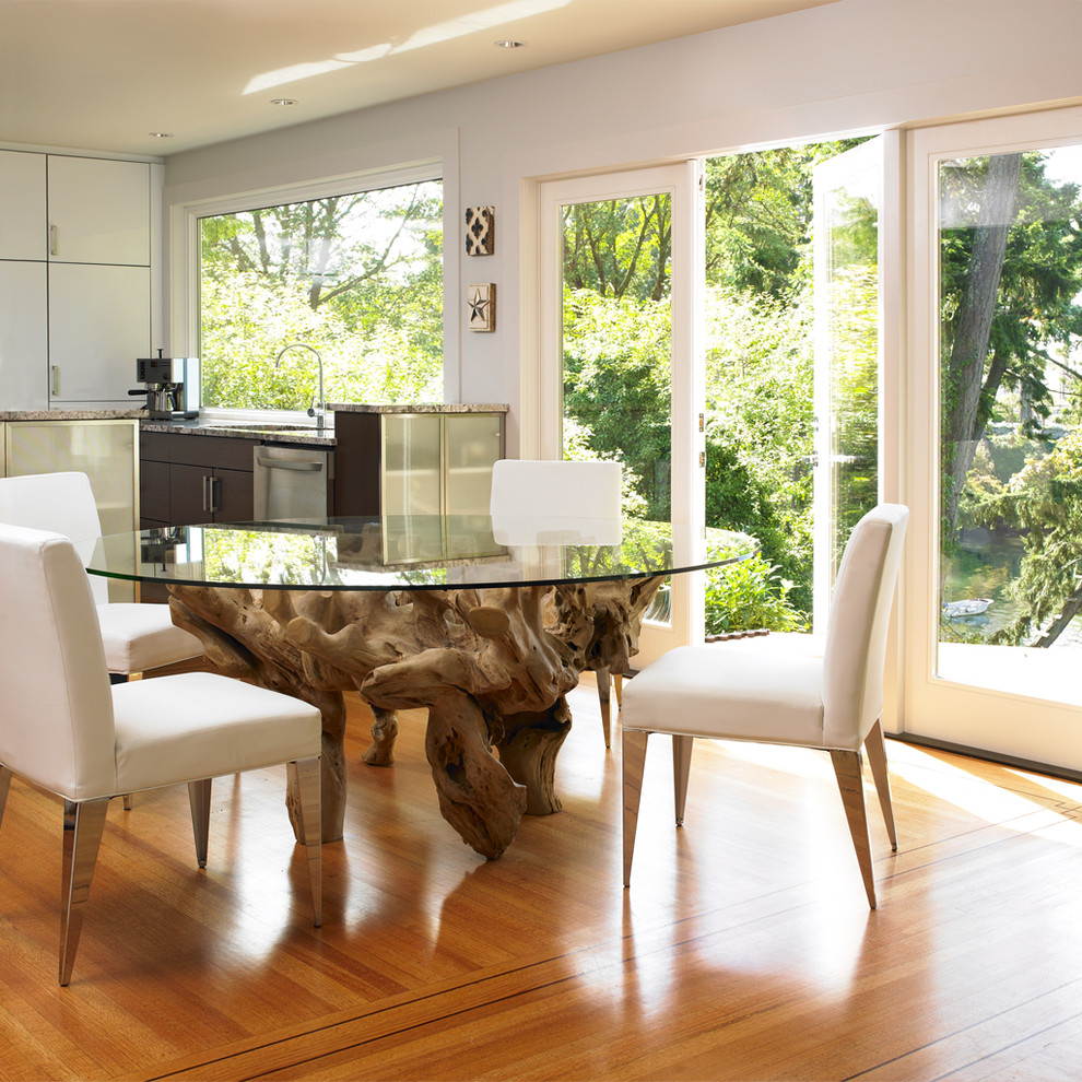Kitchen/dining room combo - modern medium tone wood floor kitchen/dining room combo idea in Vancouver with white walls