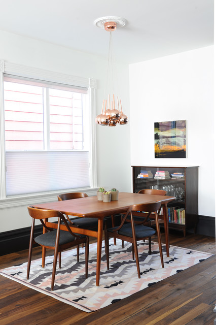 Example of an eclectic dark wood floor and brown floor dining room design in Vancouver with white walls