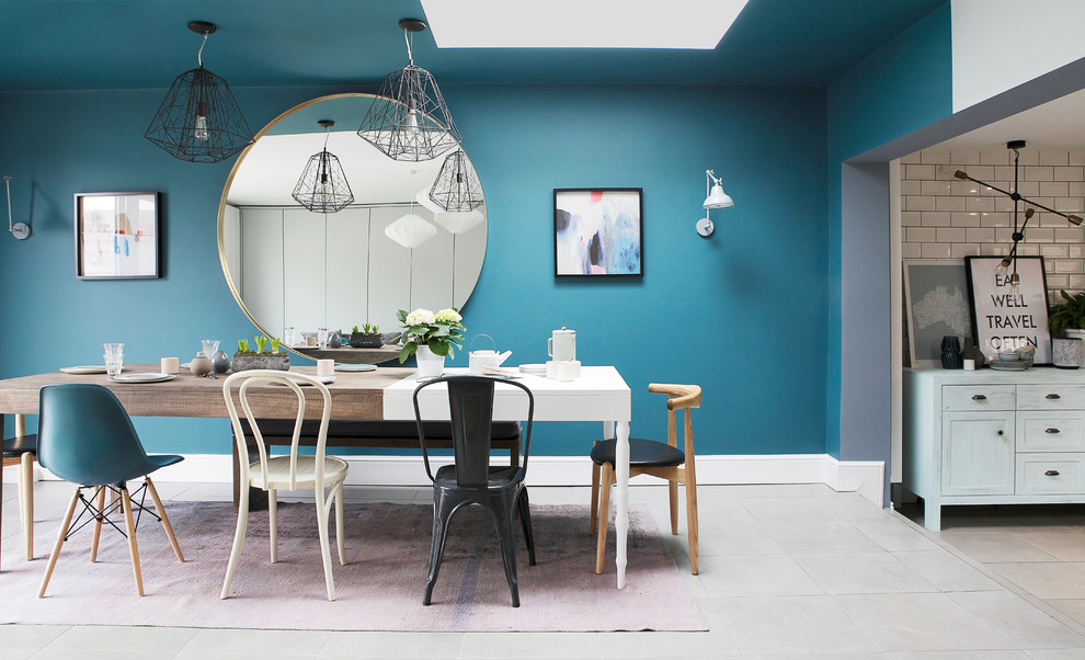 Danish dining room photo in Dublin with blue walls and no fireplace