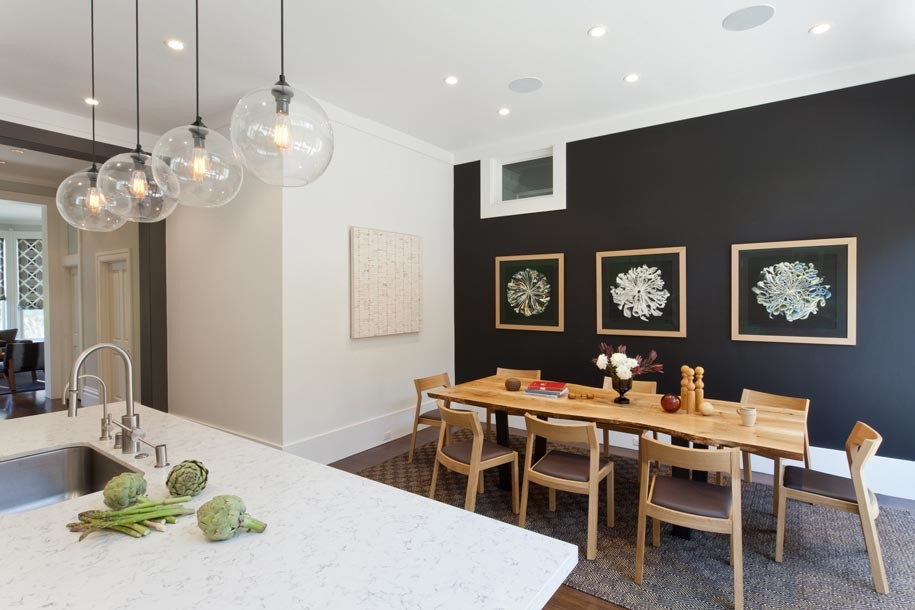 Kitchen/dining room combo - mid-sized modern carpeted kitchen/dining room combo idea in San Francisco with black walls