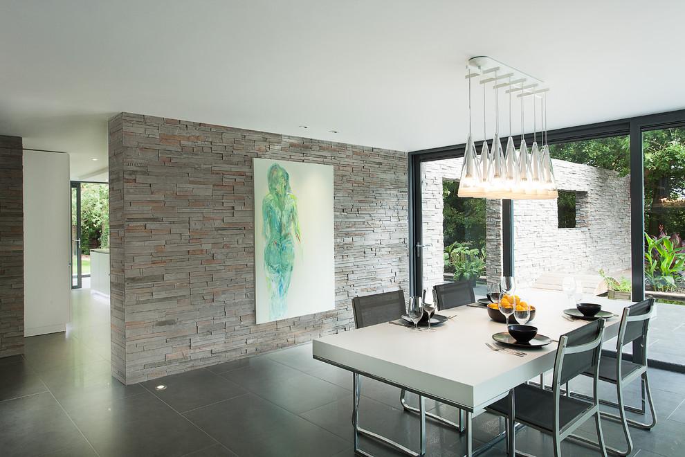 Example of a minimalist ceramic floor dining room design in Hampshire