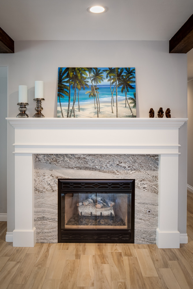 After: New facing and mantel on existing gas fireplace.