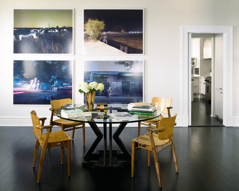 Eclectic black floor dining room photo in Chicago with white walls
