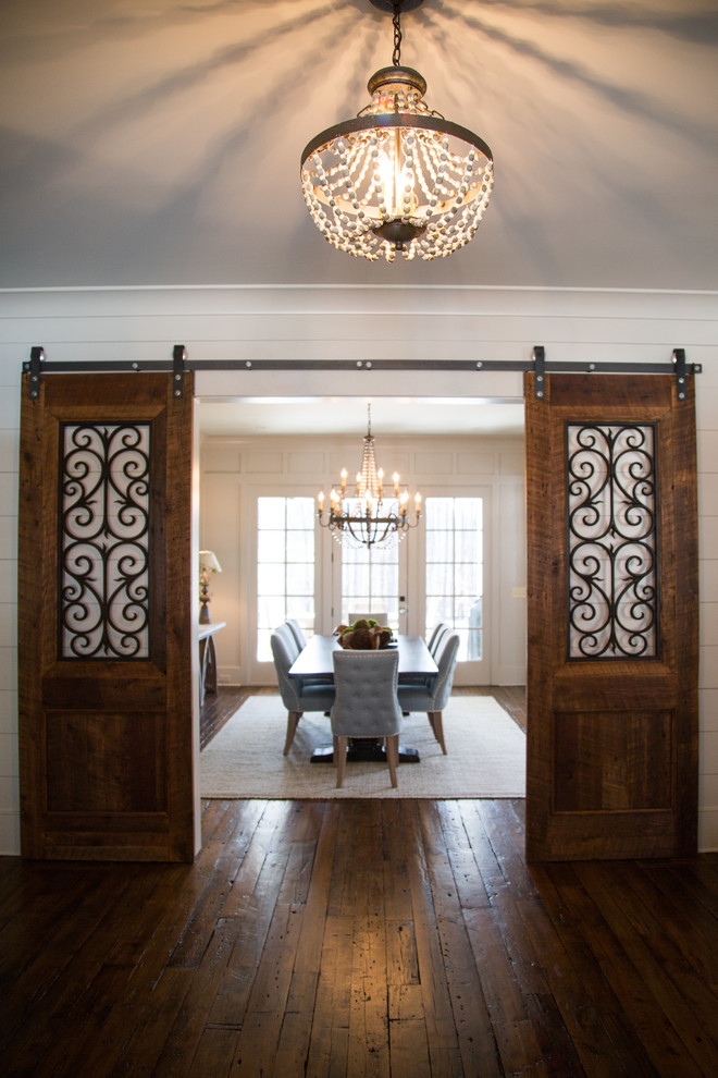 Inspiration for a mid-sized transitional medium tone wood floor enclosed dining room remodel in Atlanta with white walls
