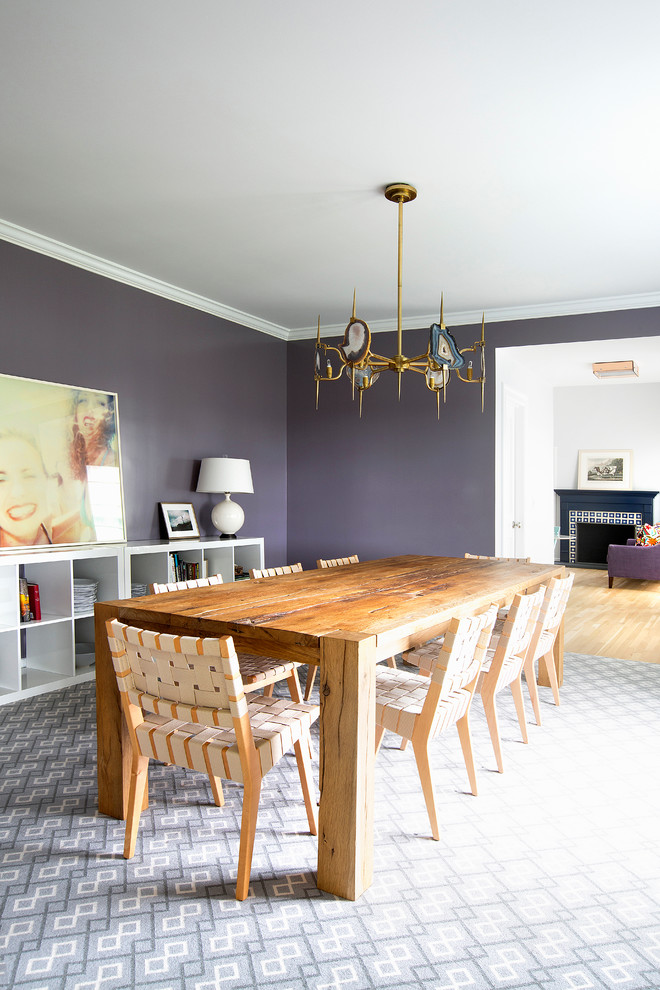 Example of a trendy dining room design in New York with purple walls