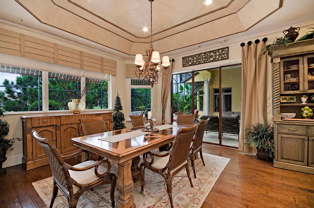 Example Of A Tuscan Medium Tone Wood Floor Dining Room Design In Miami With Beige Walls