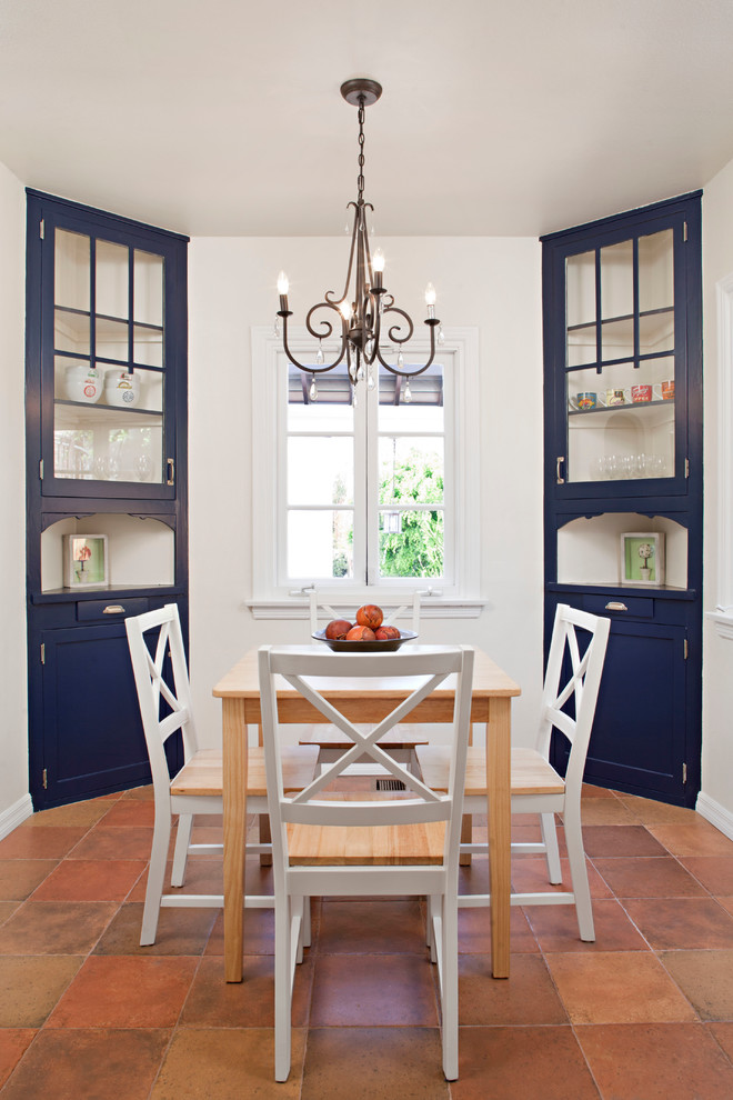 Kitchen/dining room combo - mid-sized cottage terra-cotta tile kitchen/dining room combo idea in Atlanta with white walls
