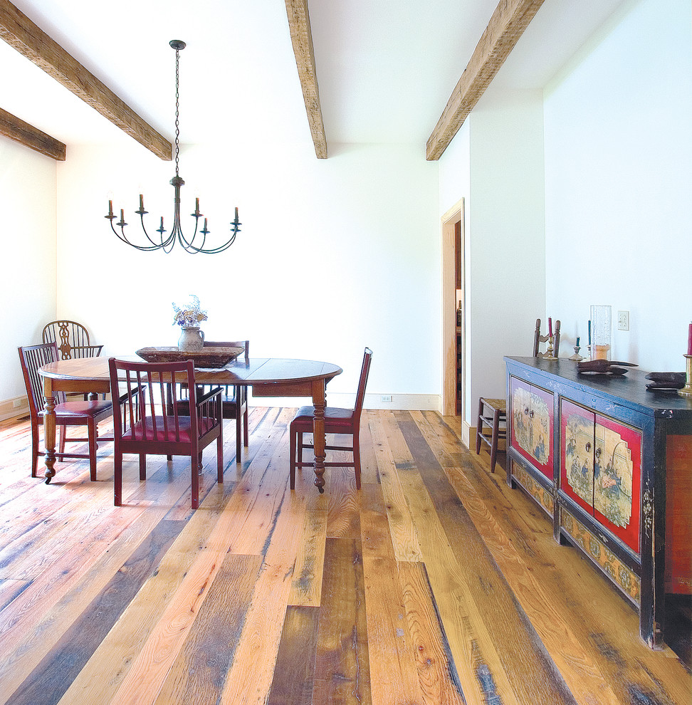 Example of a mid-sized mountain style medium tone wood floor and brown floor kitchen/dining room combo design in DC Metro with white walls and no fireplace
