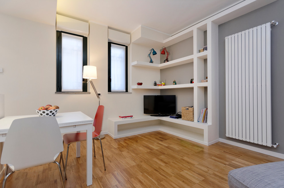 Example of a small trendy light wood floor dining room design in Milan