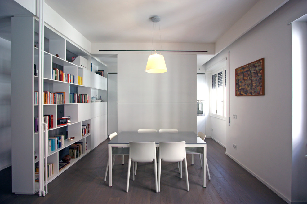 Small minimalist medium tone wood floor dining room photo in Rome with white walls