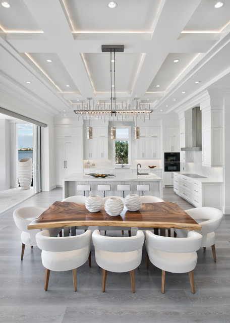 Inspiration for a contemporary gray floor kitchen/dining room combo remodel in Miami with white walls